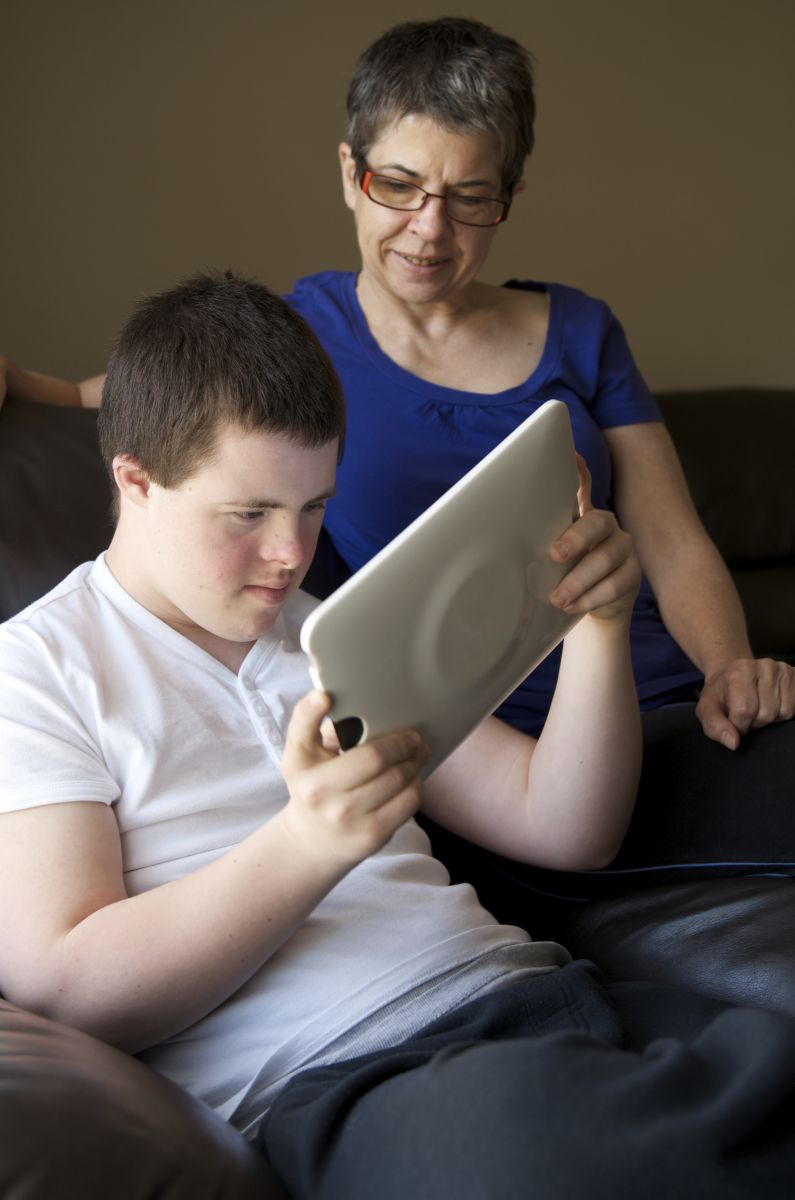 Boy using assistive technology